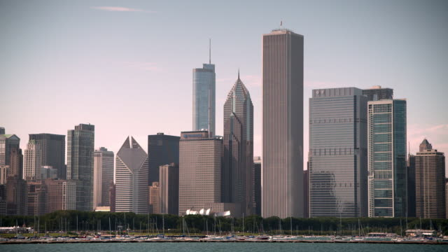 wide shot showing varied chicago skyscrapers rising into the sky behind monroe harbor, illinois, usa. - one prudential plaza stock videos & royalty-free footage