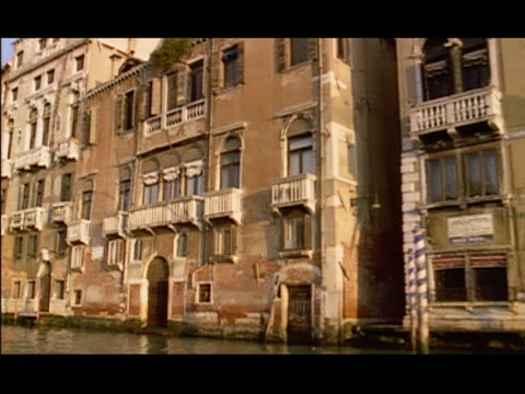 wide shot side boat point of view exteriors of weathered buildings on the grand canal / venice, italy - weathered stock videos and b-roll footage