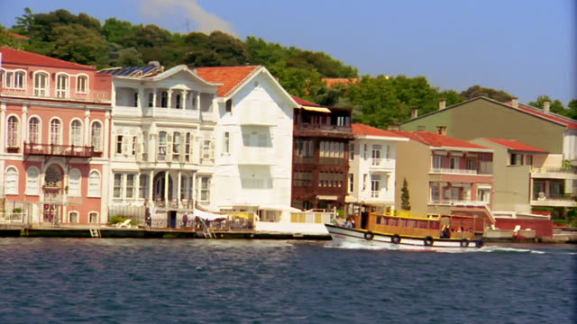 wide shot side boat point of view on bosporus strait past buildings on bank of straight and boat / istanbul, turkey - bosphorus stock videos & royalty-free footage