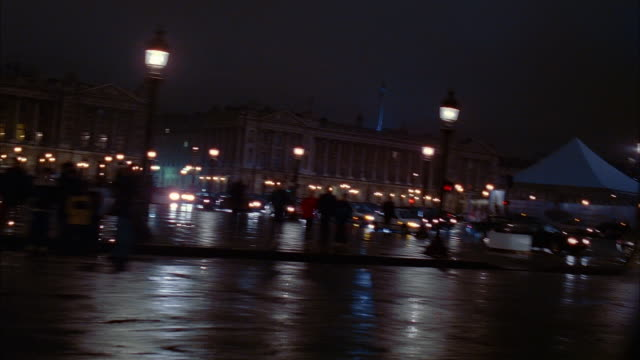 wide shot side car point of view buildings, luxor obelisk and ferris wheel at place de la concorde at night / paris - obelisk of luxor stock videos & royalty-free footage