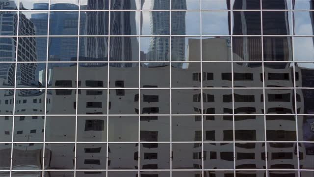 Wide shot side of office building with mirrored windows and reflection of other buildings/ Charleston, South Carolina