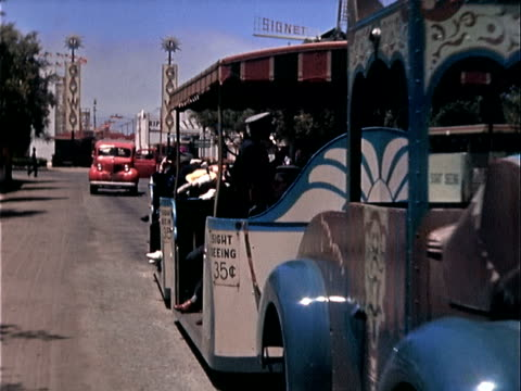 1939 wide shot sightseeing tram passing by during golden gate international exposition/ san franscisco, california - human age stock videos & royalty-free footage