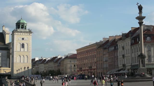 Wide shot Sigismunds Column and people in square in the Old Town area of Warsaw Poland on Monday June 16 Pedestrians walk through a square in the Old...