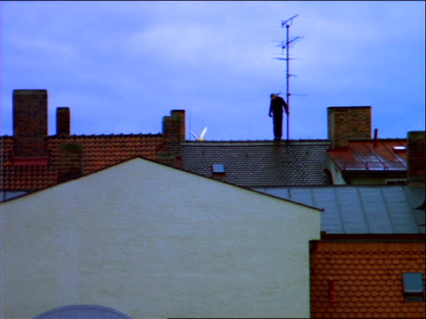 wide shot silhouette of chimney sweep walking across roof - 1992 stock videos & royalty-free footage