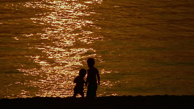 wide shot silhouetted children at st kilda beach sunset / melbourne - 2003 stock videos and b-roll footage