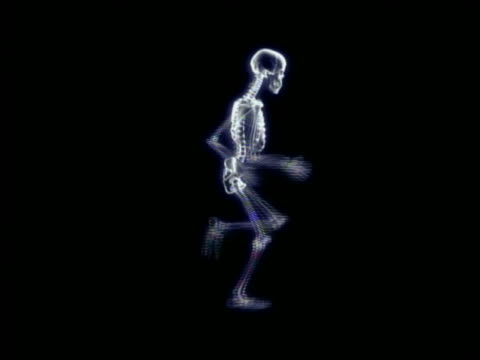 CGI wide shot skeleton running in place with black background