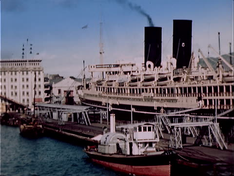 1939 Wide shot small and large boats in harbor/ Hong Kong