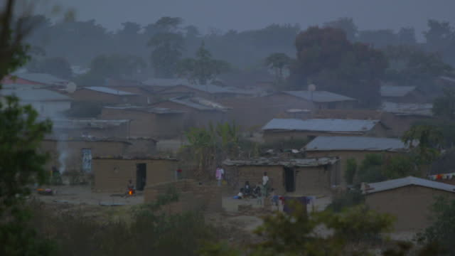 wide shot, small angolan village - village stock videos & royalty-free footage