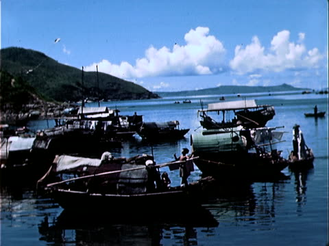1939 wide shot small boats in harbor/ hong kong - 1939 stock-videos und b-roll-filmmaterial