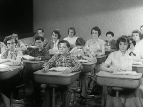 1955 wide shot sneezing boy in classroom making classmates disappear with each sneeze / audio - sneezing stock videos & royalty-free footage