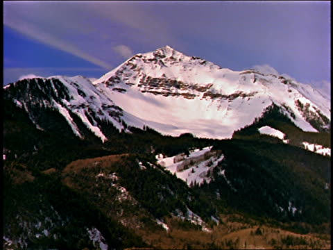 wide shot snowy mountain with lower forest-covered mountains in foreground / san juan mountains, near telluride, colorado - 1989 stock videos & royalty-free footage