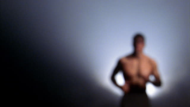 wide shot soft focus barechested muscular man running - soft focus stock videos & royalty-free footage