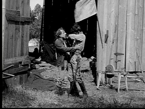 1913 reenactment b/w wide shot soldier carrying wounded man to field hospital attended by nurses, nun, and army officer during civil war battle reenactment / usa  - 1913 stock videos & royalty-free footage