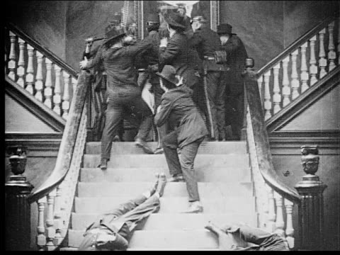 1916 b/w wide shot soldiers and other men beating older man atop staircase landing - 1916 stock videos & royalty-free footage