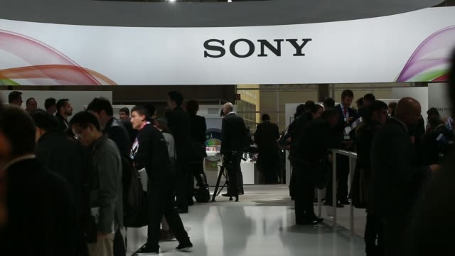 wide shot sony corp pavilion on day two of the mobile world congress in barcelona spain on tuesday feb 25 attendees walk through sony display area... - sony stock videos & royalty-free footage