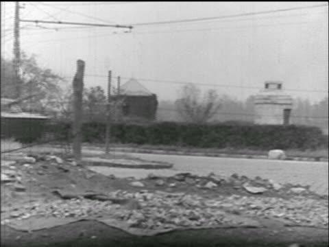 wide shot soviet tanks speeds down street past civilians / hungarian uprising - 1956 stock-videos und b-roll-filmmaterial