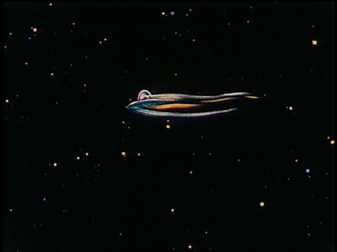 1948 animated wide shot pan spaceship flying through space with upside down alien pilot - ufo stock videos & royalty-free footage