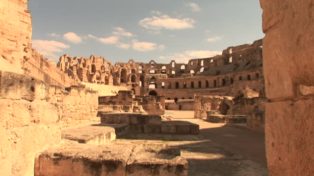 wide shot static _ tourists walk through an ancient colosseum in rome, italy / rome, italy - colosseum rome stock videos and b-roll footage