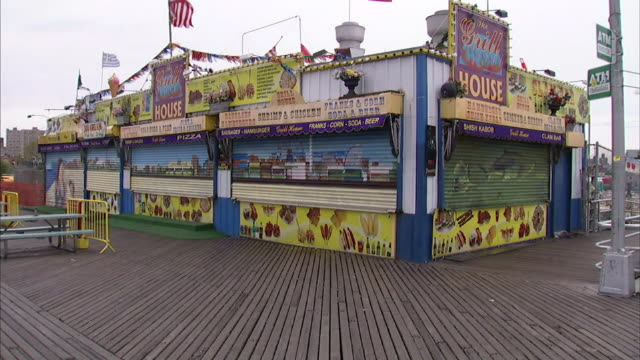 wide shot static - a coney island concession stand awaits opening. / new york city, new york, usa - coney island stock videos & royalty-free footage