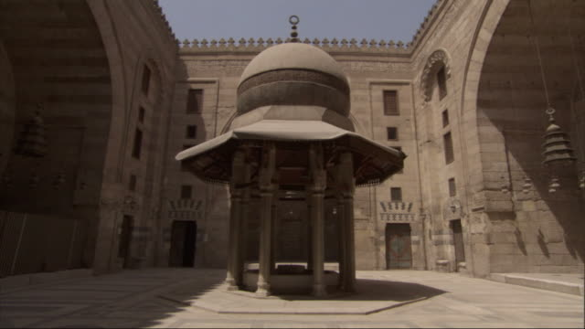 wide shot, static - a gazebo decorates a courtyard / egypt - gazebo stock videos and b-roll footage