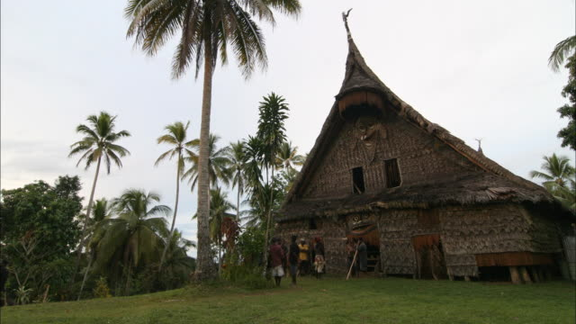 wide shot static - night falls over a spirit house. / papua new guinea - papua stock videos and b-roll footage