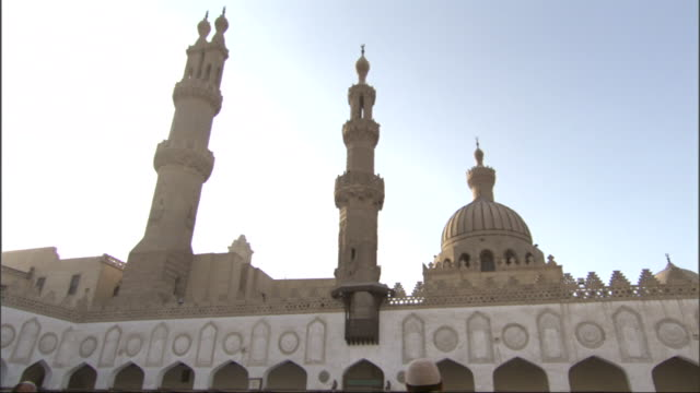 Wide Shot, static - Sunlight illuminates the towers of a mosque / Egypt