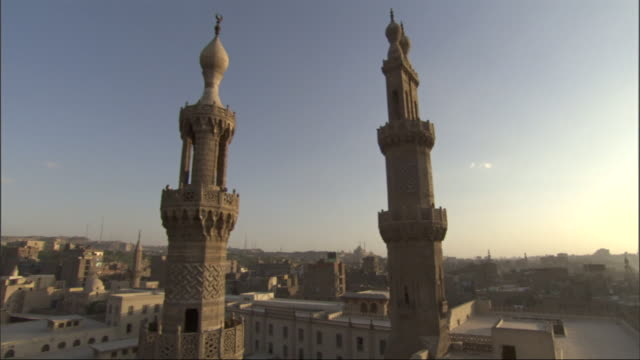 Wide Shot, static - Two minarets display a beautiful example of Islamic architecture / Egypt
