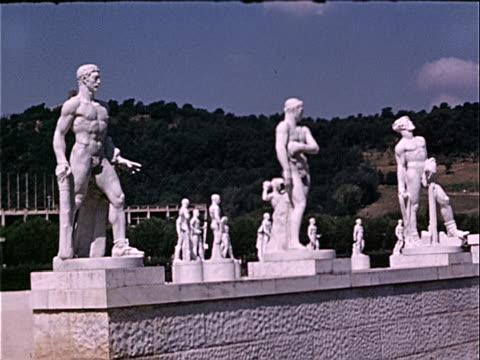 1939 wide shot statues lining wall of foro italico / rome, italy  - male likeness stock videos & royalty-free footage
