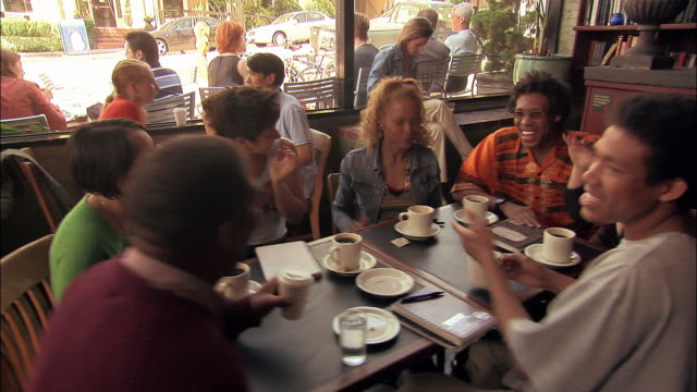 wide shot students and professor talking in coffeehouse / seattle - seattle coffee stock videos and b-roll footage