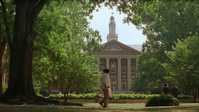 wide shot students, faculty and staff in front of building (manning hall) on campus of college or university / university of north carolina - campus stock videos & royalty-free footage