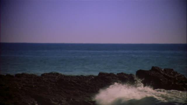 Wide shot sun shining on breaking waves/ Los Angeles, California