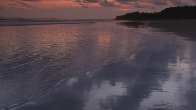 wide shot; sunset on beach - costa rica stock videos & royalty-free footage