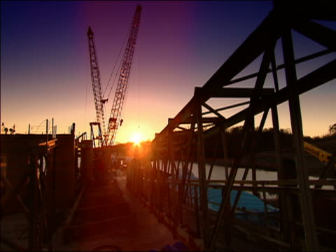 wide shot sunset on construction equipment at olmsted lock/ illinois - 桁橋点の映像素材/bロール