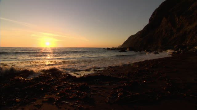 wide shot sunset over pacific / monterey county, california - ragged point stock videos and b-roll footage