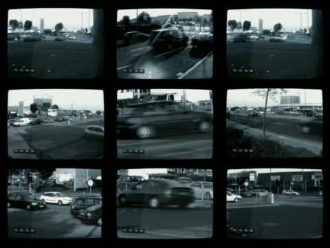 Wide shot surveillance CAM footage frames of traffic on roads