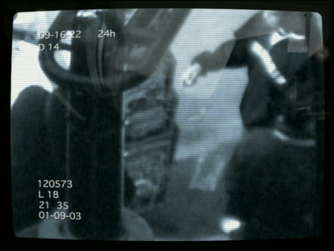 wide shot surveillance cam footage of men exchanging money for goods - moving image stock videos & royalty-free footage