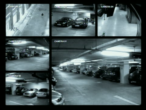 wide shot surveillance cams in parking garage - parken stock-videos und b-roll-filmmaterial