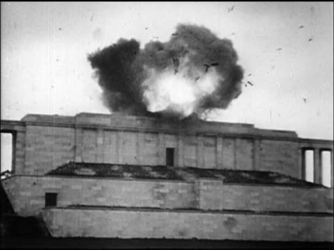 b/w 1945 wide shot swastika sculpture on roof of nuremberg stadium exploding / newsreel - nazi swastika stock videos & royalty-free footage