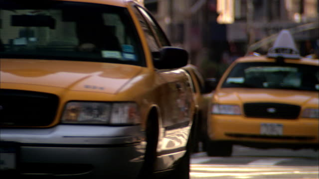 wide shot taxis and other traffic on new york city street - taxi driver stock videos and b-roll footage