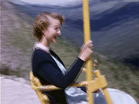 1951 wide shot teenage girl riding ski lift in banff national park / banff, alberta, canada  - tourist stock videos & royalty-free footage