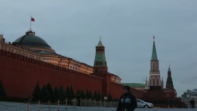 wide shot the gum department store decorated with illuminations and st basils cathedral in the red square moscow russia on monday dec 22 the... - moskau stock-videos und b-roll-filmmaterial
