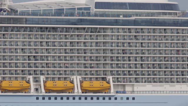 Wide shot the Quantum of the Seas cruise ship sails into Hakata Bay in Fukuoka Japan Wide shot the Quantum of the Seas cruise ship sails through...