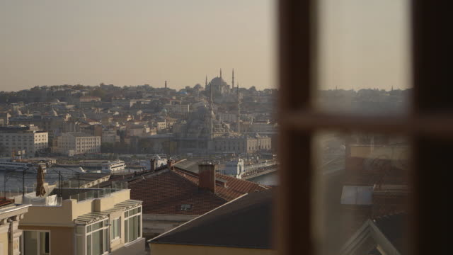 wide shot through a window of the yeni and atik ali pasha mosques in istanbul, turkey. - yeni cami mosque stock videos & royalty-free footage