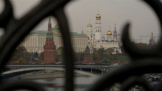 wide shot through ironwork of the kremlin on a cloudy day in moscow, russia. - authority stock videos and b-roll footage