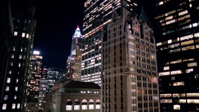 wide shot tilt down ai building, chase manhattan tower, liberty tower and federal reserve bank at night / nyc - gothic stock videos & royalty-free footage