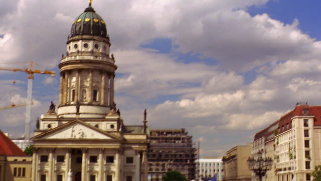 wide shot tilt down PAN domed French Cathedral at Gendarmenmarkt / Berlin, Germany
