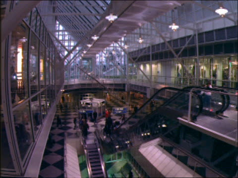 stockvideo's en b-roll-footage met wide shot tilt down of interior of modern munich airport - 1992