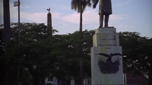 wide shot tilt up statue of pablo arosemena in park/ panama city, panama - central america stock videos & royalty-free footage