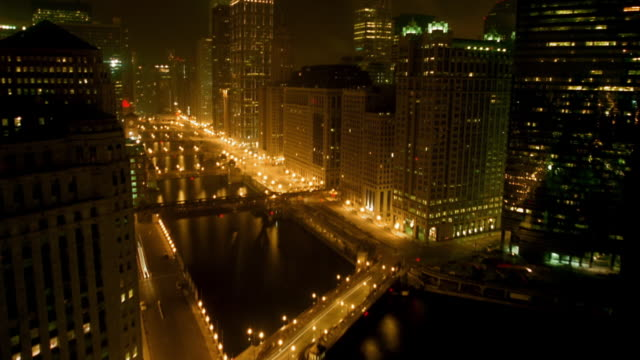 wide shot tilt up time lapse traffic on streets and bridges over chicago river / night to dawn - 2002 stock videos & royalty-free footage