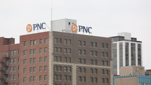 wide shot tilt up to signage of a pnc financial services group inc atop a building in peoria illinois us on monday july 10 pan left to right to... - financial building stock videos and b-roll footage